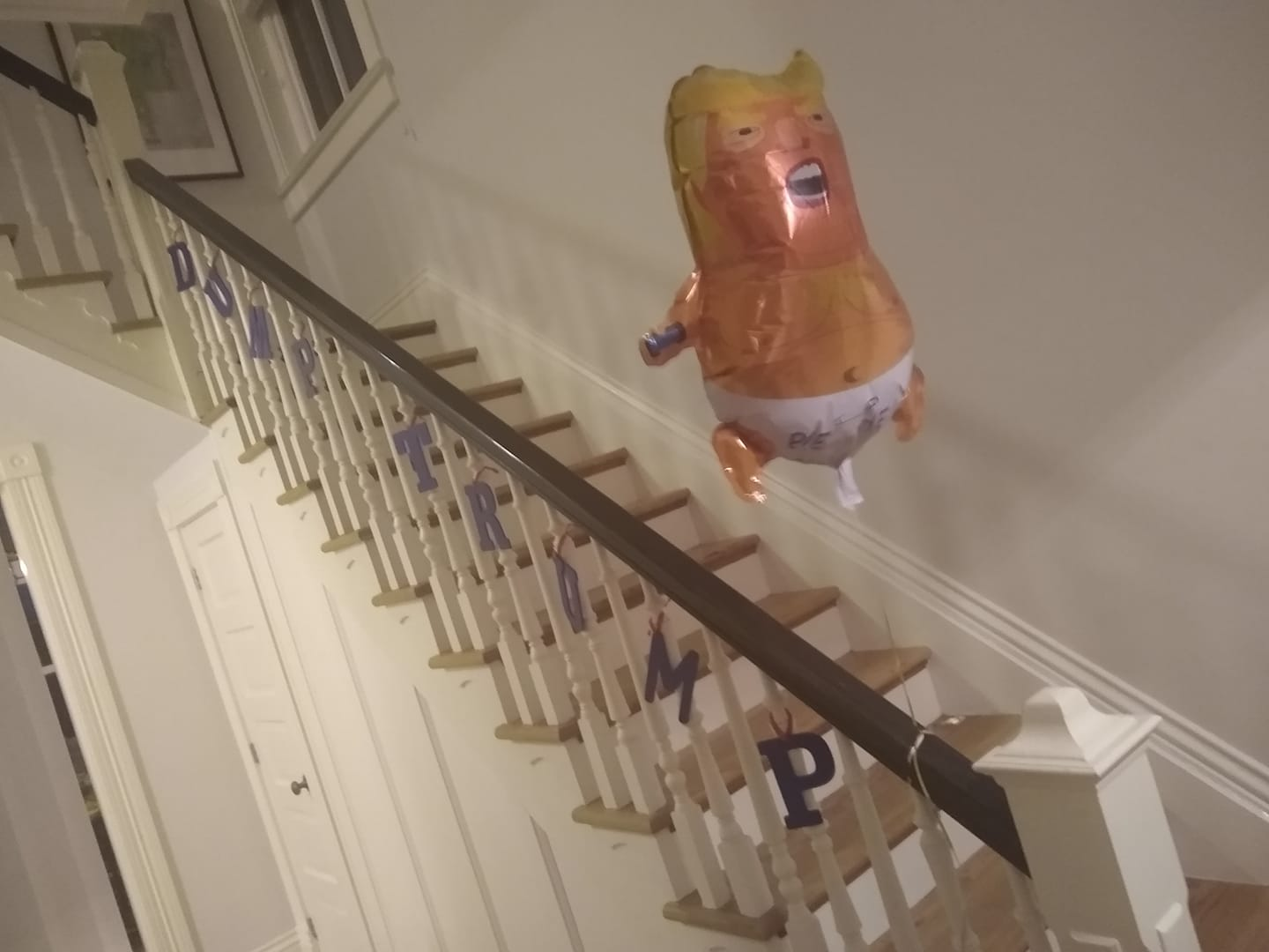 dump trump staircase and baby balloon